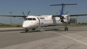 A Bombardier Q400 turboprop plane. Bombardier has sold the unit making these planes to Longview, and at the same time laid off 5,000 employees.