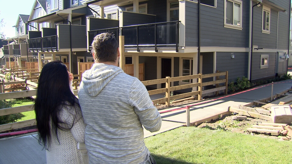 Jasmine Corbet and her husband David Zeiger look at the townhome they were supposed to purchase. (CTV)
