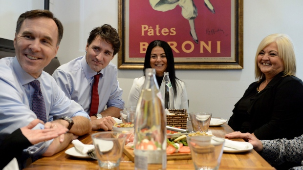 Finance Minister Bill Morneau, Prime Minister Justin Trudeau and Small Business and Tourism Minister Bardish Chagger chat over lunch with the owners of family-run restaurant, Pastaggio Italian Eatery, in Whitchurch-Stouffville, Ont., on Monday, October 16, 2017. THE CANADIAN PRESS/Nathan Denette