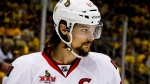 FILE - In this May 16, 2017, file photo, Ottawa Senators' Erik Karlsson prepares for a face-off during the second period of Game 2 of the Eastern Conference finals against the Pittsburgh Penguins, in Pittsburgh. Senators captain Erik Karlsson has no timetable to get back on the ice or play following offseason foot surgery. Karlsson, the runner-up for the Norris Trophy as the NHL's top defenseman, says he hasn't been able to do anything for three months since the operation in June to repair torn tendons in his left foot. (AP Photo/Gene J. Puskar, File)