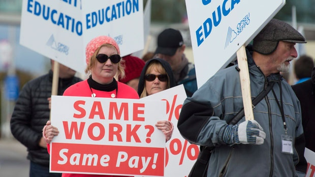 College faculty walk the picket line outside Algonquin College, in Ottawa on Monday, October 16, 2017. Faculty at Ontario's 24 colleges are walking picket lines today, affecting more than 500,000 students in the province. THE CANADIAN PRESS/Adrian Wyld