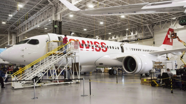Bombardier employees work on CSeries 300 jets at the company's plant in Mirabel, Que., on September 28, 2017. Bombardier Inc. has announced it will partner with Netherlands-based aerospace giant Airbus on its CSeries program. (THE CANADIAN PRESS/Ryan Remiorz)