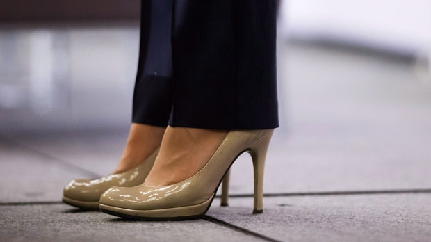"British Columbia Premier Christy Clark wears high heels while addressing the Council of Forest Industries convention in Vancouver, B.C., on Friday April 7, 2017. The British Columbia government has banned mandatory high heels in the workplace in a move to address ""discriminatory"" dress codes. Labour Minister Shirley Bond says requiring women to wear high heels on the job is also a health and safety issue. THE CANADIAN PRESS/Darryl Dyck"