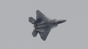 A U.S. F-22 stealth fighter flies during the press day of the 2017 Seoul International Aerospace and Defense Exhibition at Seoul Airport in Seongnam, South Korea, Monday, Oct. 16, 2017. (AP / Ahn Young-joon)