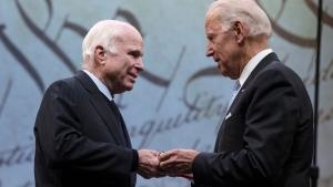 U.S. Sen. John McCain, R-Ariz., receives the Liberty Medal from the chair of the National Constitution Center's Board of Trustees, former Vice President Joe Biden in Philadelphia, Monday, Oct. 16, 2017. (AP Photo/Matt Rourke)