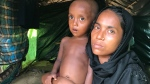 Rohingya refugee Nur Hawa holds her ill daughter in the Bulukhali refugee camp, in Bangladesh, in October 2017. (Peter Akman / CTV News)