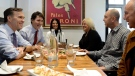 Finance Minister Bill Morneau and Prime Minister Justin Trudeau chat over lunch with Cathy Cassano, Carol Cassano, Joey Rampulla and Charlie Rampulla, the owners of family-run restaurant, Pastaggio Italian Eatery, in Whitchurch-Stouffville, Ont., on Monday, October 16, 2017. THE CANADIAN PRESS/Nathan Denette