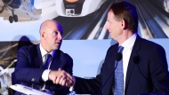 Bombardier president and CEO Alain Bellemare, left, and president Canada and chief operating officer of North America for Airbus Helicopters Romain Trapp shake hands during a press conference in Montreal on October 16, 2017. Bombardier Inc. has announced it will partner with Netherlands-based aerospace giant Airbus on its CSeries program. THE CANADIAN PRESS/Paul Chiasson