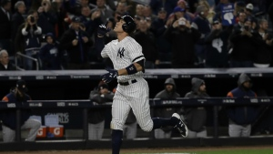 New York Yankees' Aaron Judge hits a three-run home run during the fourth inning of Game 3 of baseball's American League Championship Series against the Houston Astros in New York on Monday, Oct. 16, 2017. (AP / David J. Phillip)