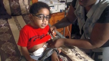 Two-year-old A.J. Burgess needs a kidney transplant, but his surgery is in limbo because his father, who is a perfect match, violated his probation. (WGCL / CBS)