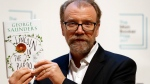 Author George Saunders of the United States with his book 'Lincoln in the Bardo' during a photocall with all six shortlisted authors of the 2017 Man Booker Prize for Fiction, in London, Monday, Oct. 16, 2017. (AP Photo/Kirsty Wigglesworth)