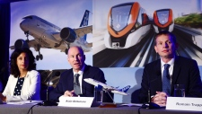 Quebec Deputy Premier and Minister of Economy, Science and Innovation Dominique Anglade, left to right, Bombardier president and CEO Alain Bellemare and president Canada and chief operating officer of North America for Airbus Helicopters Romain Trapp speak to the media during a press conference in Montreal on October 16, 2017. Bombardier Inc. has announced it will partner with Netherlands-based aerospace giant Airbus on its CSeries program. (Paul Chiasson/THE CANADIAN PRESS)