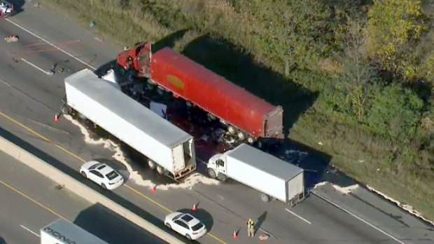 Police closed a portion of Highway 401 near Guelph Line after a multi-vehicle crash caused a diesel spill.