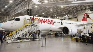 Bombardier employees work on CSeries 300 jets at the company's plant in Mirabel, Que., on September 28, 2017. Bombardier Inc. has announced it will partner with Netherlands-based aerospace giant Airbus on its CSeries program. (THE CANADIAN PRESS / Ryan Remiorz)