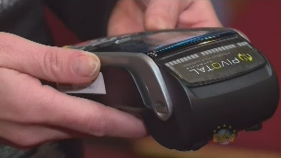 A wireless debit machine known as the 'giving terminal' is seen inside St. Mark's Anglican Church in St. John's, N.L.