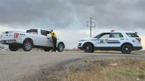 A police roadblock was set up near the Sharp Hill community to assist residents in the area who are being evacuated.