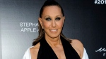 "FILE - In this June 7, 2017 file photo, Donna Karan attends the 2017 Urban Zen Stephan Weiss Apple Awards in New York. Karan says she is apologetic and embarrassed about the remarks she made last week that suggested sexual harassment victims were ""asking for it"" by the way they dressed. (Photo by Christopher Smith/Invision/AP, File)"