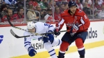 Toronto Maple Leafs defenseman Connor Carrick, left, gets tripped up against Washington Capitals left wing Alex Ovechkin, right, of Russia, during the first period of a NHL hockey game, Tuesday, Oct. 17, 2017. (AP Photo/Nick Wass)