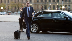 Finance Minister Bill Morneau arrives to work on Parliament Hill, in Ottawa on Monday, October 16, 2017. THE CANADIAN PRESS/Sean Kilpatrick