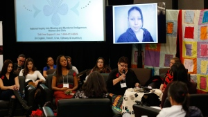 The family of Nicole Daniels speaks to commissioner Michelle Audette at the opening day of hearings at the National Inquiry into Missing and Murdered Indigenous Women and Girls in Winnipeg, Monday, October 16, 2017. THE CANADIAN PRESS/John Woods/Pool