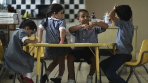 Children journal about Hurricane Maria at Ramon Marin Sola Elementary School which opened its doors as a daytime community center after the passing of Hurricane Maria in Guaynabo, Puerto Rico, on Friday, Oct. 13, 2017. (AP / Carlos Giusti)