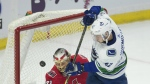 Vancouver Canucks centre Alexander Burmistrov tips the puck past Ottawa Senators goalie Craig Anderson to score during second period NHL action in Ottawa on Tuesday, Oct. 17, 2017. (Adrian Wyld / THE CANADIAN PRESS)