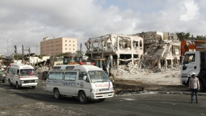 Ambulances carrying wounded victims passes the scene of Saturday's truck bomb blast, as they head to airport to be airlifted by Turkish air ambulance for treatment in Turkey, in Mogadishu, Somalia on Monday, Oct, 16, 2017. (AP / Farah Abdi Warsameh)