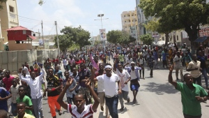 Angry protesters march in Mogadishu, Somalia, on Oct. 18, 2017. (Farah Abdi Warsameh / AP)