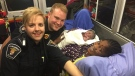 Ottawa Paramedics Courtney Healey and Matt Friesen pose with mom and newborn baby boy born in the ambulance while en route to hospital on Wednesday, Oct. 18, 2017. (Ottawa Paramedics)