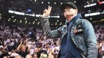 The Tragically Hip lead singer Gord Downie salutes fans during the first half of game three of an NBA playoff series basketball game between the Toronto Raptors and Cleveland Cavaliers in Toronto on Friday, May 5, 2017. (THE CANADIAN PRESS/Frank Gunn)