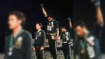 In this Oct. 16, 1968, file photo, extending gloved hands skyward in racial protest, U.S. athletes Tommie Smith, center, and John Carlos stare downward during the playing of 'The Star-Spangled Banner' after Smith received the gold and Carlos the bronze medal in the 200 meter run at the Summer Olympic Games in Mexico City. Australian silver medalist Peter Norman is at left. (AP)
