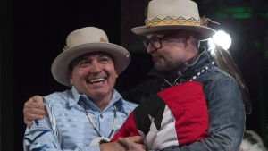 Assembly of First Nations Chief Perry Bellegarde (left) is embraced by Tragically Hip frontman Gord Downie at the AFN Special Chiefs assembly in Gatineau, Que., on Dec. 6, 2016. (Adrian Wyld / THE CANADIAN PRESS)