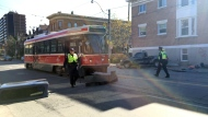 Police at the scene of a crash in Parkdale involving a TTC streetcar that left a cyclist dead. (Danny Pinto/CTV News Toronto)