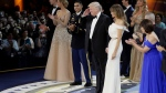 U.S. President Donald J. Trump salutes the crowd after dancing with first lady Melania Trump at The Salute To Our Armed Services Inaugural Ball Friday, Jan. 20, 2017, in Washington. (AP Photo/David J. Phillip)