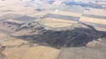 An aerial photo shows burnt fields near Leader, Sask., following a grass fire Tuesday, Oct. 17, 2017, that prompted the community's evacuation. (Jason Gizen/Twitter)