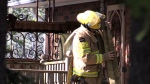 Firefighters find flames coming out home's windows