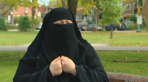 Warda Naili wears a niqab after converting to Islam.