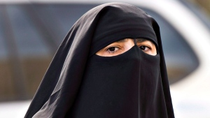 A woman wears a niqab as she walks Monday, September 9, 2013 in Montreal. The Quebecnational assembly has passed a controversial religious neutrality bill that obliges citizens to uncover their faces while giving and receiving state services.THE CANADIAN PRESS/Ryan Remiorz