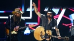 Chris Stapelton, left, and Jason Aldean perform at 2017 CMT Artist of the Year Awards at Nashville's Schermerhorn Symphony Center in Nashville, Tenn. on Wednesday, Oct. 18, 2017. (Wade Payn/ Invision)