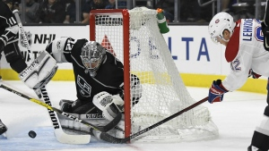 Montreal Canadiens left wing Artturi Lehkonen, right, tries to get a shot in on Los Angeles Kings goalie Jonathan Quick during the first period of an NHL hockey game in Los Angeles on Wednesday, Oct. 18, 2017. (AP / Mark J. Terrill)