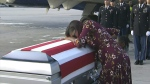 Myeshia Johnson cries over the casket in Miami of her husband, Sgt. La David Johnson, who was killed in an ambush in Niger. (WPLG via AP)