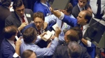 Traders on the floor of the New York Stock Exchange, on Oct. 19, 1987. (Peter Morgan / AP)