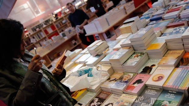 In this file image, a woman browses at a book fair Thursday March 20, 2014.  (AP Photo/Christophe Ena)