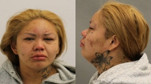 Angela Bluecoat, 36, is wanted on a theft charges after a blind woman was robbed in North York. (Toronto police handout)