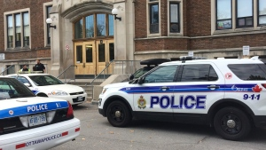 Ottawa Police outside Glebe Collegiate on Thursday, Oct. 19, 2017. Police arrested a young man after a bullet was found on the grounds.