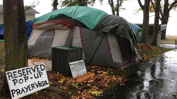 Tents are set up at the Oak bay homeless c& in Victoria Wednesday Oct.18 2017. THE CANADIAN PRESS/Dirk Meissner & Homeless B.C. nomads pitch tents at Oak Bay park after week at city ...