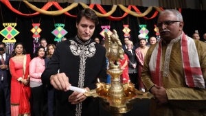 Prime Minister Justin Trudeau lights a candle for Diwali in this image shared on his Twitter account Monday, Oct. 16, 2017.