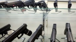 Guns are seen on display at a gun store in Miami on Wednesday, June 29, 2016. (AP Photo/Alan Diaz)