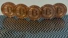 This June 17, 2014 photo taken in Washington, D.C. shows bitcoin medals. (AFP / Karen BLEIER)