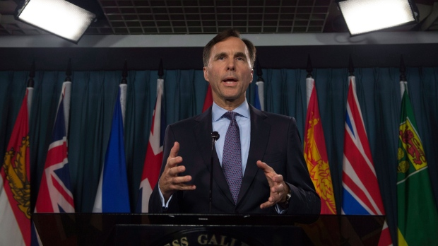 Minister of Finance Bill Morneau speaks with the media before Question Period on Parliament Hill, in Ottawa on Thursday, October 19, 2017. THE CANADIAN PRESS/Adrian Wyld